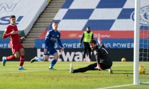 Leicester's Harvey Barnes slots the ball past Liverpool's goalkeeper Alisson for the Foxes' third.