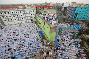 Prayers take place on the streets and rooftops in Howrah, India