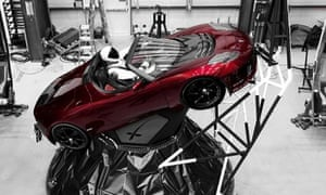 A mannequin 'Starman' sits at the wheel of a Tesla Roadster in this photo posted on the Instagram account of Elon Musk. The car will be on board when SpaceX launches its new rocket on Tuesday.
