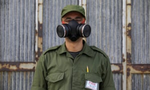 A military reservist, picture in Havana. Troops were on the streets of Havana, knocking on doors and fumigating homes as part of a preventative campaign against the Zika virus.