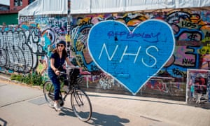 A cyclist rides past graffiti paying tribute to NHS workers in east London. The capital has seen a big increase in bike use.
