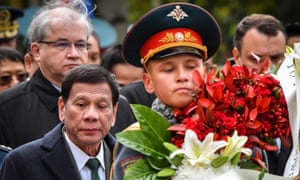 Philippine President Rodrigo Duterte (front L) attends a wreath-laying ceremony at the Tomb of the Unknown Soldier in Moscow.