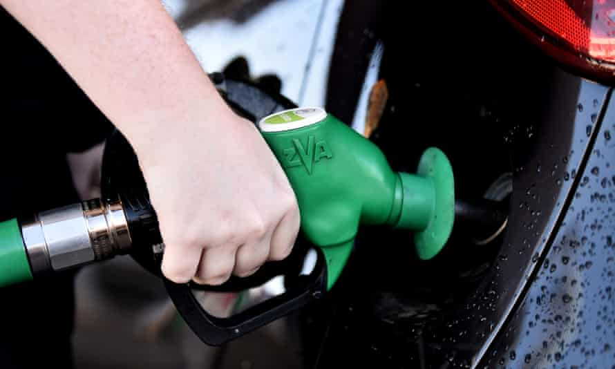 Someone fills a car with unleaded petrol at a petrol station