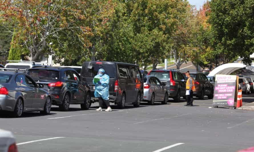 Motorists wait in line for a Covid-19 test in Auckland as New Zealand's largest city goes into lockdown.