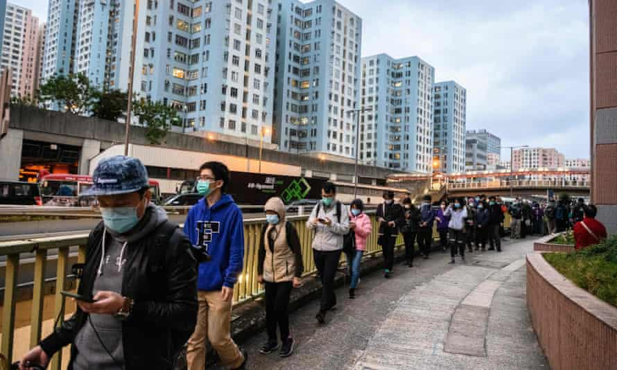 People in Hong Kong form long queues to buy face masks to protect from the coronavirus outbreak.