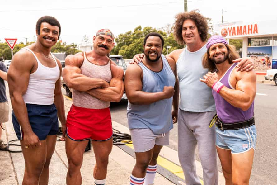 Cast members of Young Rock (l-r) Joseph Lee Anderson as Rocky Johnson, Brett Azar as The Iron Sheik, Nate Jackson as Junkyard Dog, Matthew Willig as Andre The Giant and Kevin Makely as Macho Man.