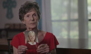 'Terrible acts of violence, treated as mass entertainment' ... Joyce Lemons, mother of alleged Lucas victim Debbie Sue Willamson, holding her daughter's high school graduation photo.