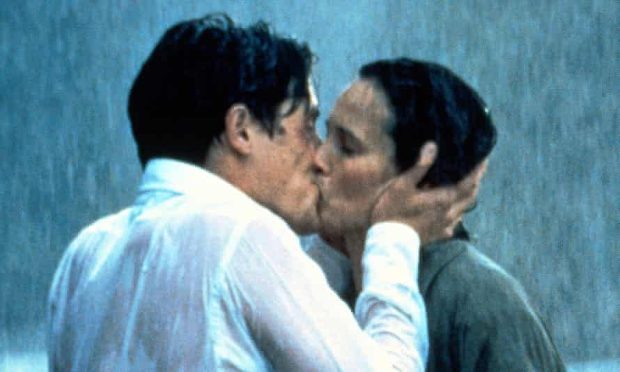 Charles and Carrie kiss in the rain in a scene from the film, Four Weddings and a Funeral
