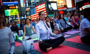 'Today's cities are cleaner, greener and safer than many suburbs and rural areas' ... New Yorkers practise yoga in Times Square.