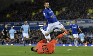 Cenk Tosun of Everton jumps over Ederson as the City keeper beats him to the ball.