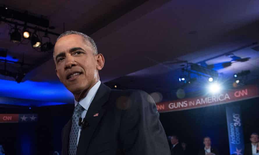 US president Barack Obama at a town hall meeting with CNN's Anderson Cooper on reducing gun violence.
