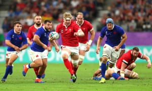 Aaron Wainwright (center) breaks away to score a first-half try for Wales.