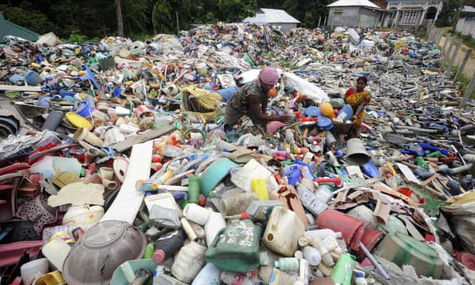 Indian ragpickers search for recyclable items
