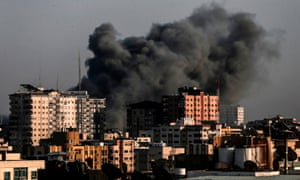 Smoke billows from a targeted neighbourhood in Gaza City during an Israeli airstrike on Sunday.