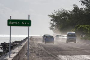 Cars on the Nippon causeway that joins Bairiki and Betio on South Tarawa.