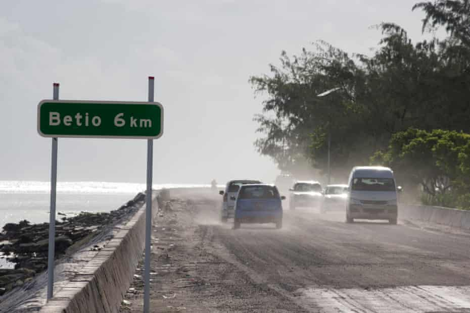 Cars on the Nippon causeway that joins Bairiki and Betio on South Tarawa.