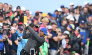Tiger Woods tees off at the 4th hole on a day when he struggled almost from the first shot.