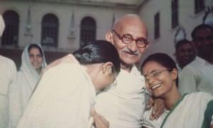 Mahatma Gandhi with Abha and Manu.