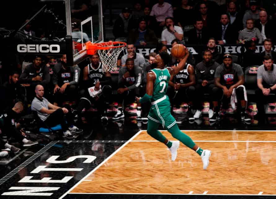 Jaylen Brown dunks during a game against the Brooklyn Nets