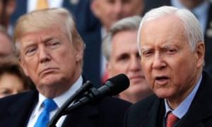 Donald Trump, left, listens to Orrin Hatch give a speech