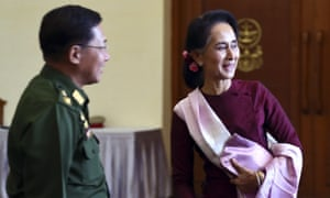 Aung San Suu Kyi and General Min Aung Hlaing during their earlier meeting in December to discuss the transfer of power following her party's landslide election win.
