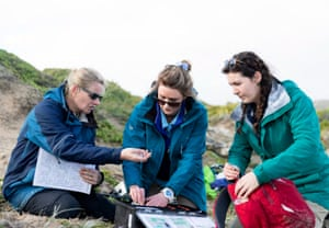 Left, Department for Environment and Water (DEW), Dr Rachael Gray with University of Sydney School of Veterinary Science Shannon Taylor and PhD students Mariel Fulham, collecting and labeling samples collected from the sea lion pups.