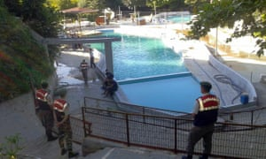Turkish paramilitary police officers investigate the deaths of five people at a water park in Akyazı.