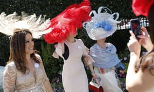 Women pose on arrival on Ladies' Day at Royal Ascot.