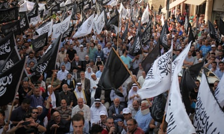 Thousands march through Hebron, in the West Bank, against the restrictions imposed on al-Aqsa mosque.