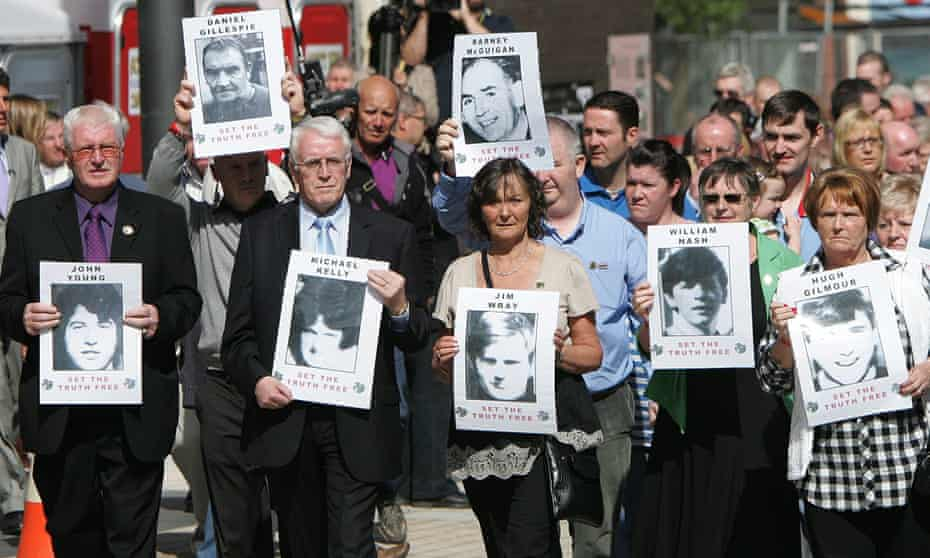 Familles and friends of those killed on Bloody Sunday in 1972 march in Derry in 2010