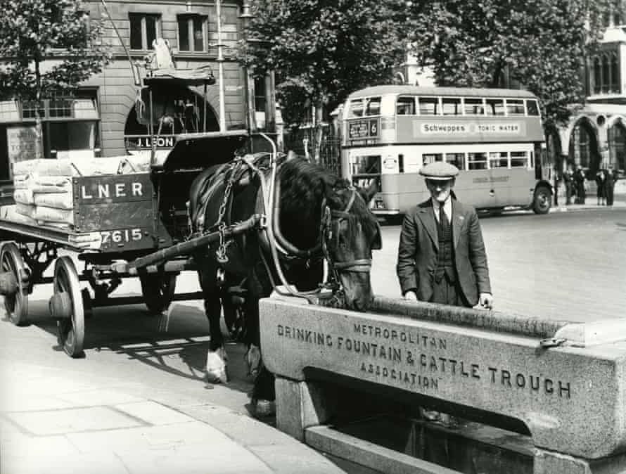 Horse-drawn and motorised traffic in London in the 1930s.