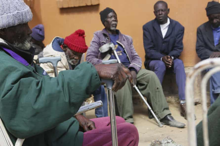 Residents wait to be served a meal at Melfort Old People's home on the outskirts of Harare, Zimbabwe.