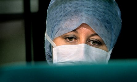 Theatre nurse wearing a surgical mask