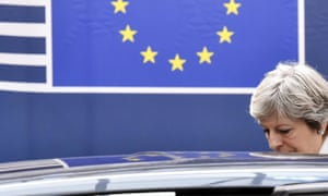 Theresa May leaving an EU summit in Brussels in 2017.