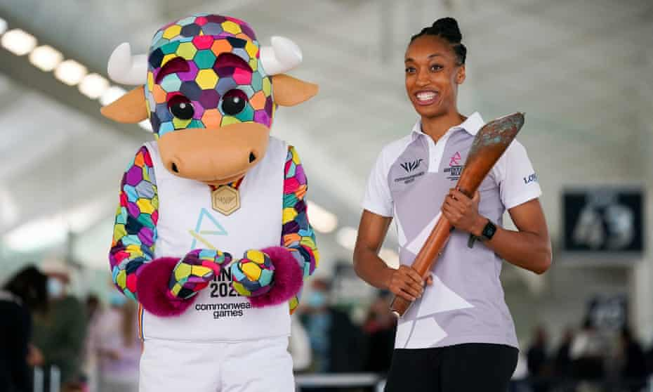 The England netball player Layla Guscoth with the Commonwealth Games baton, alongside Perry the official mascot for the Birmingham 2022 Games.