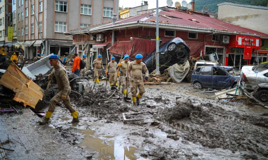 Soldiers arrive to clear the debris after the Ezine River broke its banks during flash floods in Bozkurt in the Black Sea region of Turkey.