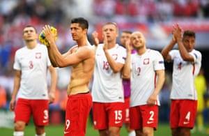 Robert Lewandowski applauds the fans at the end of the match.