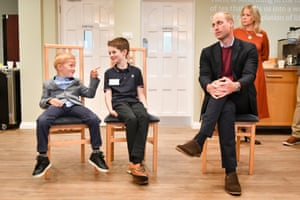 Chudleigh, UKThe Duke of Cambridge sits alongside Joseph Dowden, 6, from Surrey (L) and Oliver Myers, 10, from Leeds, during a visit to the Fire Fighters Charity's Harcombe House centre to hear about the support that it provides to members of the UK's fire and rescue services and their families