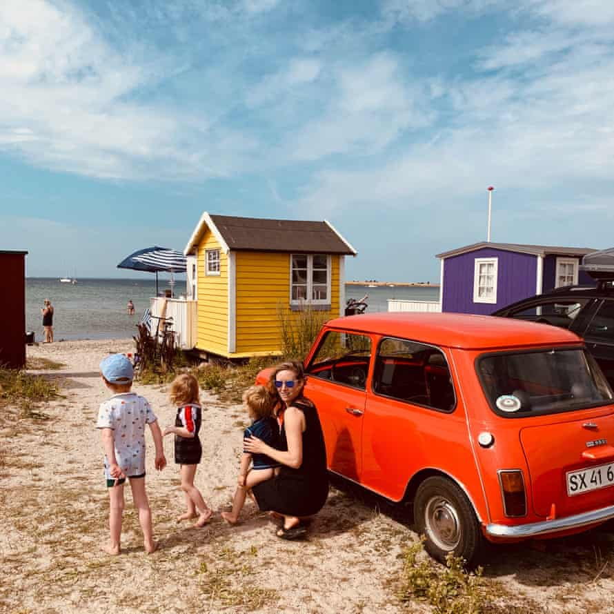 Helen Russell, at 'her' hut, with her son and two-year-old twins. Aero, Denmark.
