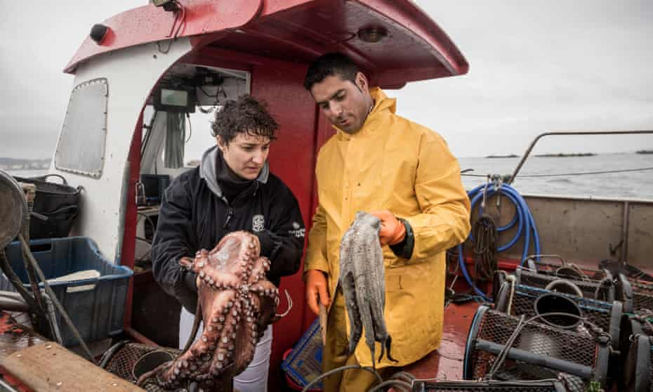 Chef Nieves Barragán Mohacho and fisherman Felix Piñeiro inspect the day's catch.