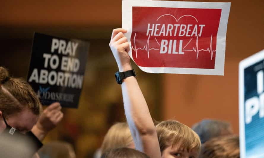 A person holds up a sign reading 'Heartbeat bill' in Columbia, South Carolina. A homophobic lobbyist coined the term 'heartbeat bill'.