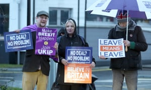 Leave supporters wave banners as Prime Minister Theresa May departs Allstate in Belfast after speaking to business representatives on her Brexit plans