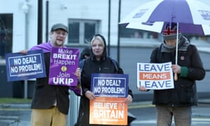 Leave supporters wave banners in Belfast during a visit by Theresa May in February.