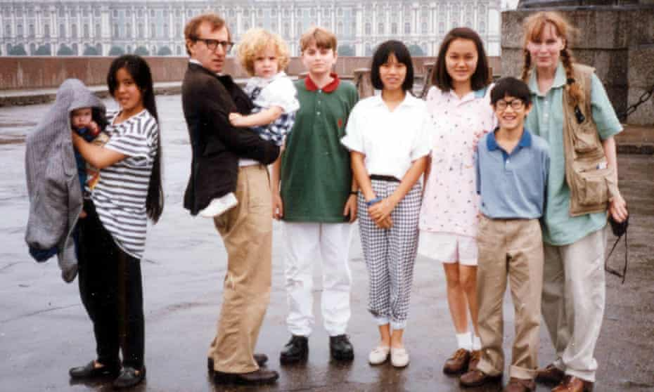Moses (front right) with Woody Allen and Mia Farrow and children Satchel, Lark, Dylan, Fletcher, Daisy and Soon-Yi.