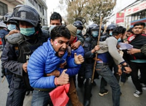 Protesters are detained by police in Kathmandu, Nepal