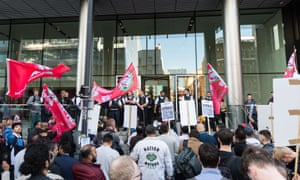 Police officers secure Uber HQ office building in London during a protest by Uber drivers