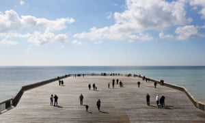 Residents enjoy the view from the long-awaited new pier at Hastings.