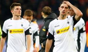 Jonas Hofmann and Lars Stindl walk from the pitch with the Gladbach fans' whistles in their ears.