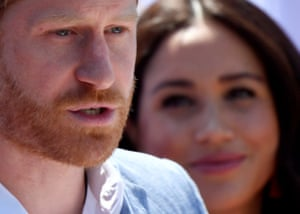 Johannesburg, South Africa. Prince Harry, Duke of Sussex, gives a speech as his wife Meghan, Duchess of Sussex, looks on