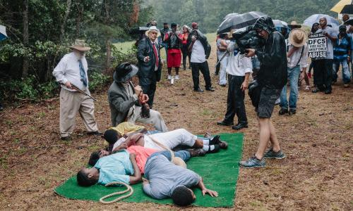 Spectators and camera crew at the final scene of the re-enactment
